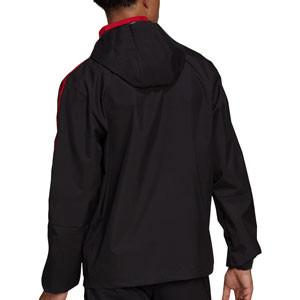 Cortavientos adidas United All Weather - Chaqueta cortavientos con capucha para entrenadores adidas del Manchester United - negra