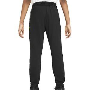 Pantalón Nike niño Dry Strike - Pantalón largo de entrenamiento de fútbol infantil Nike - negro y amarillo - trasera