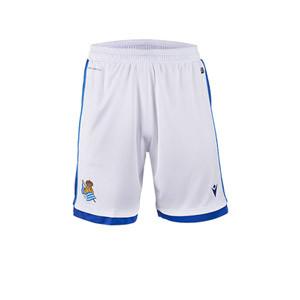 Short Macron Real Sociedad niño 2020 2021 - Pantalón corto infantil Macron primera equipación Real Sociedad 2020 2021 - blanco - miniatura