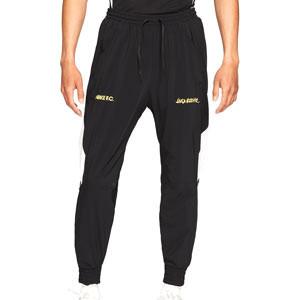 Pantalón Nike FC Dri-Fit Woven Joga Bonito - Pantalón largo de calle Nike de la colección Joga Bonito - negro - frontal