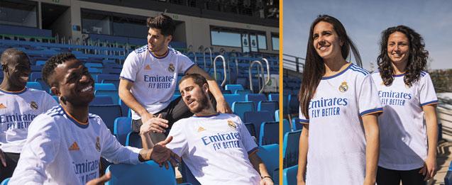 Jugadores y jugadoras de fútbol del Real Madrid con la nueva camiseta 1 equipación 2021 2022 color blanco con detalles naranjas.