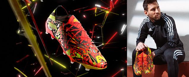 Imagen de la última bota de fútbol de Lionel Messi de color naranja, negro y amarillo flúor.