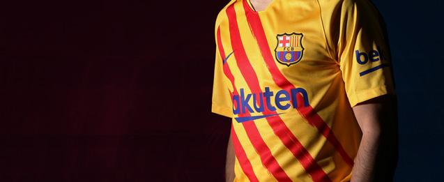 camiseta del FC Barcelona amarilla con cuatro franjas rojas