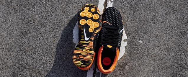 Encuentra las botas de fútbol sala Nike React Gato en naranja y negro