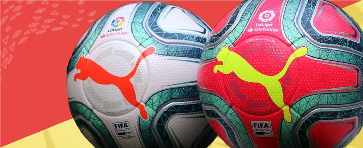 2 balones Puma para niño, el de la izquierda balón La Liga Española LFP 2019 2020 y el de la derecha balón de invierno La Liga Española LFP 2019 2020