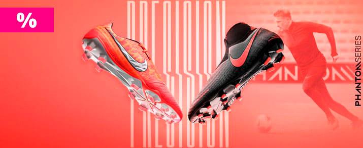 Rebajas botas de fútbol Nike Phantom para niño. Colección phantom fire, 2 botas, una de color rosa rojizo y el otro de color negro con detalles rojos.