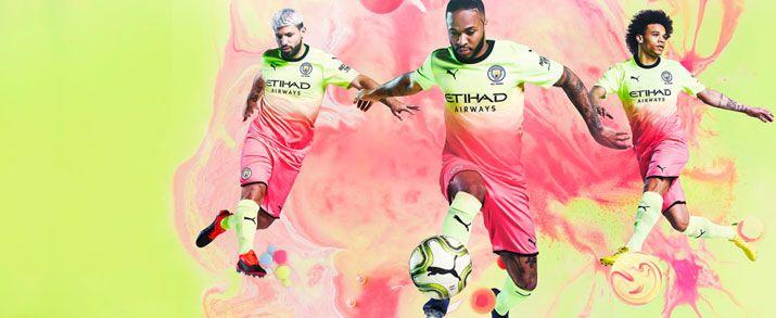 Camiseta de la segunda equipación infantil 2020 Manchester City, diseño muy llamativo en amarillo flúor que se fusiona en un degradado con el color naranja.