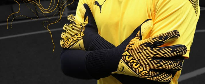 Guantes marca Puma de la colección Spark Pack color amarillo para niño
